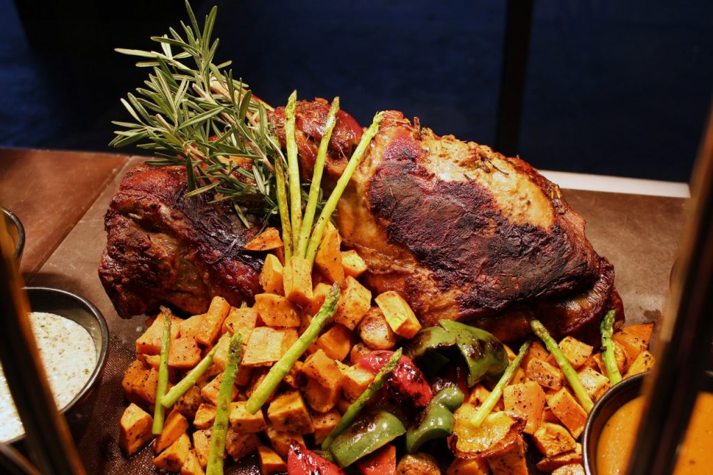 Carving Station - Slow Roasted Bone in Lamb Leg with Mint Aioli, Dijon Mustard, Rosemary Jus and Sweet Potatoes