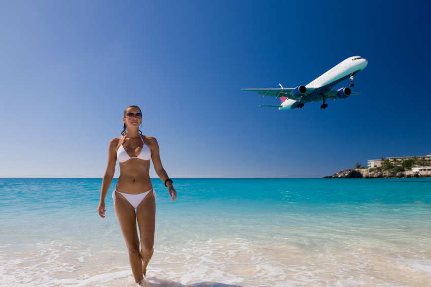 young woman enjoying her vacation at the beach in Saint Martin